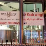 Banner greets holiday revelers at Hellbent Brewery