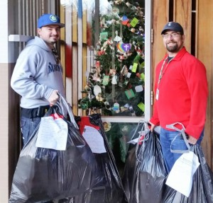 Seattle Parks employees Jacob S. and Ryan S. put their elf hats on and picked up LCHP holiday donations for our local Community Centers.
