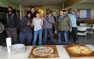 Residents at the Maple Leaf SHARE shelter give a cheer for the pizza and a Super Bowl day!