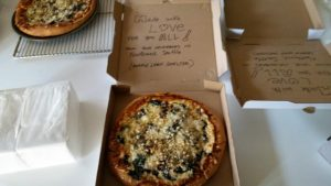 homemade veggie pizzas and a message