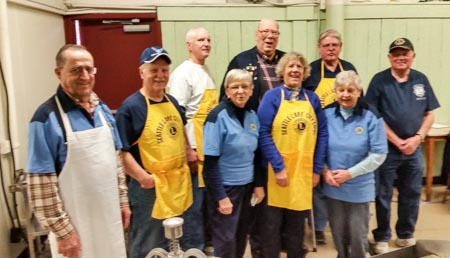 Lake City Lions pause from serving a hearty breakfast