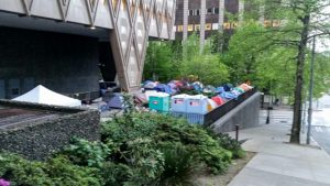 For safety's sake residents from Maple Leaf Shelter have camped out downtown at King County Bldg.  Having serous funding problems, the cost efficient program         is trying to encourage King County, since the government funding stopped in 2013.