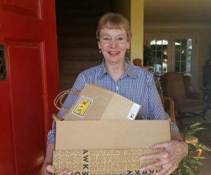MC2 former board member Karen Artz got the bags filled