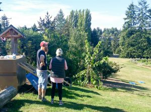 City Fruit Staff engage neighbor on MCGO
